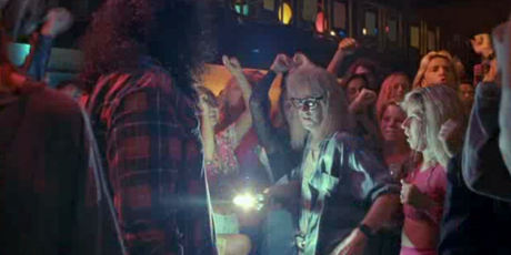 Garth Algar makes his way through busy crowd