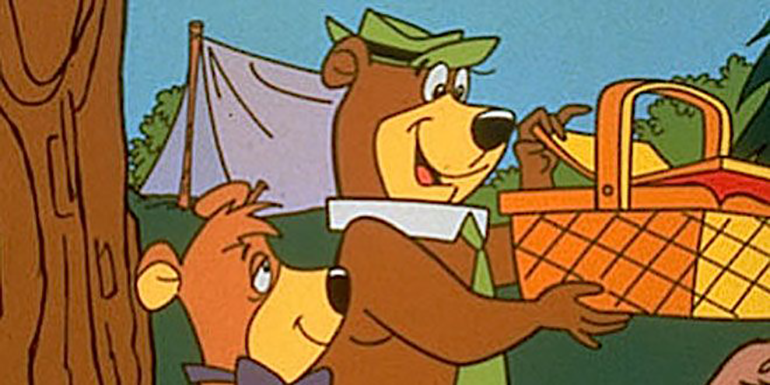Yogi Bear and Boo-Boo enjoy a picnic basket and a dumb network card selection pun. (image property of Warner Bros.)