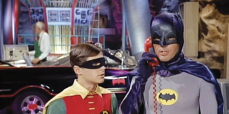 Batman and Robin are struggling to hear Commissioner Gordon over their VoIP-reliant Batphone. (image property of Warner Bros.)